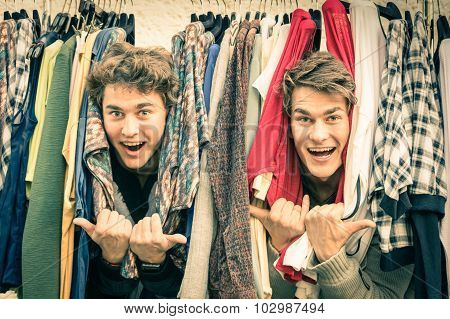 Young Hipster Brothers At The Weekly Cloth Market - Best Friends Sharing Free Time Having Fun