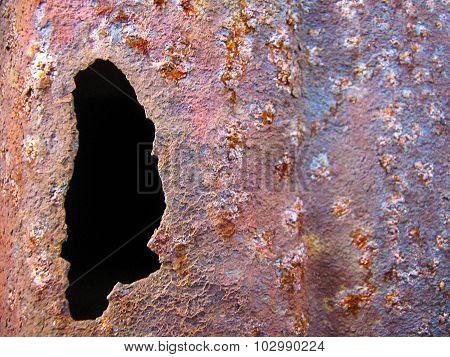 Hole In Rusty Metal