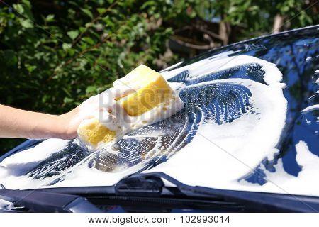 Hand washing car window