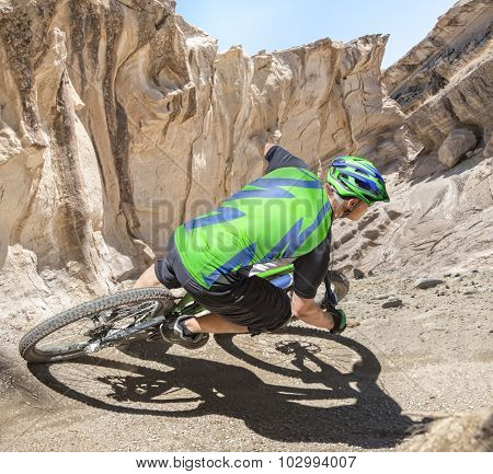 Mountain Biker Riding Canyon