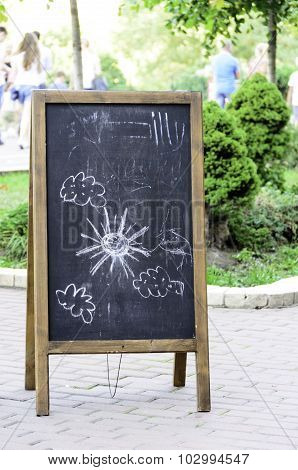 Blackboard With Children's Drawings.