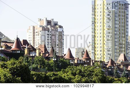 Villas On The Background Of High-rise Buildings.