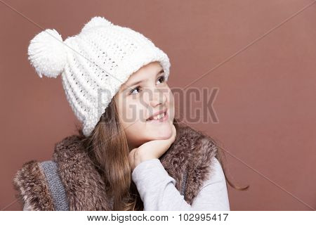Beautiful little girl smiling on brown background