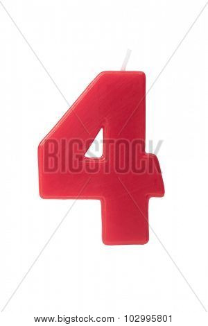 Red birthday candle in the form of the number four on white background
