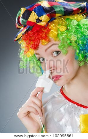 Clown with electric plug in funny concept