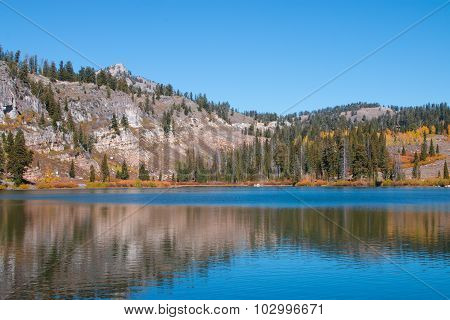 Glacial lake with autumn foliage