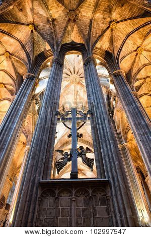 BARCELONA, SPAIN - MAY 02: Low Angle View of Decorative Cross and Pillars Inside Historic Barcelona Cathedral, Barcelona, Spain. May 02, 2015