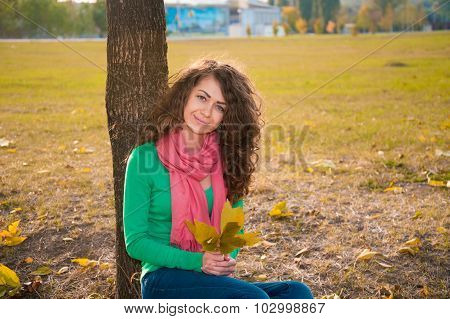 curly young woman in autumn
