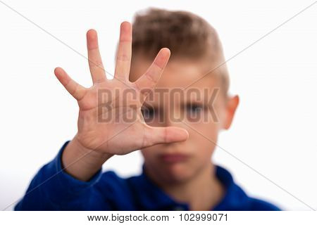 Boy With Raised Hand Making Stop Gesture