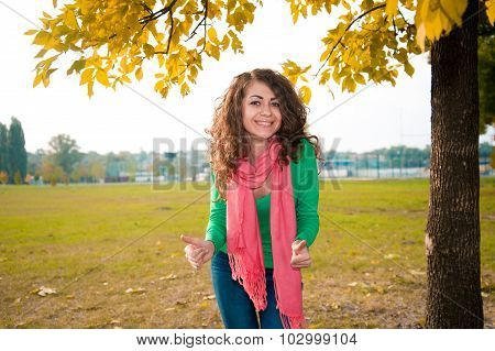 Portrait of beautiful curly young woman smiling