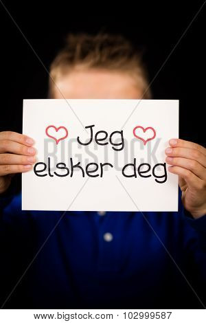 Child Holding Sign With Norwegian Words Jeg Elsker Dig - I Love You