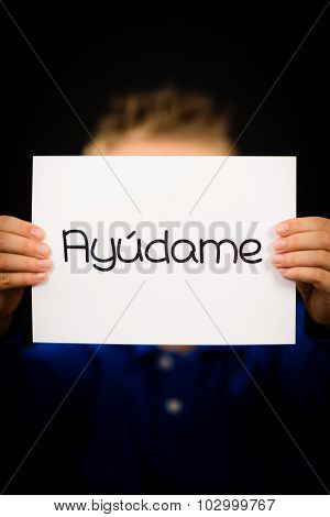 Child Holding Sign With Spanish Word Ayudame - Help Me