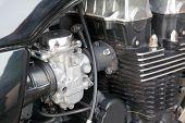 stock photo of carburetor  - Close up photo of motorcycle engine carburetor and cylinder head - JPG