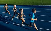 ������, ������: Multiracial Athletes Practicing Running On Racetrack