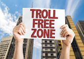 Troll Free Zone placard with skyscrappers background poster
