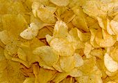 stock photo of crips  - Background made of yellow crips - JPG