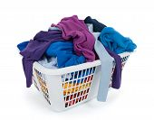 foto of laundry  - Bright clothes in a laundry basket on white background - JPG