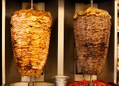 picture of shawarma  - Delicious slabs of skewered fast food shawerma chicken and lamb meat turn on a spit - JPG