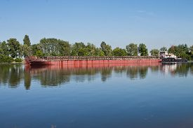 stock photo of barge  - laden barge floating on a small river - JPG