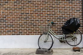 picture of dong  - parked bicycle against the brick wall in seoul south korea - JPG