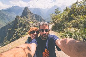 image of marsala  - Couple taking selfie on the terraces above Machu Picchu the most visited travel destination in Peru - JPG