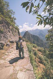 stock photo of marsala  - Backpacker exploring the steep Inca - JPG
