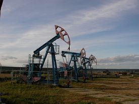 foto of raw materials  - Long line of oil pumping units on a large - JPG