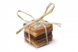 image of bonbon  -  Package with a variation of sweet caramel bonbons on white background - JPG