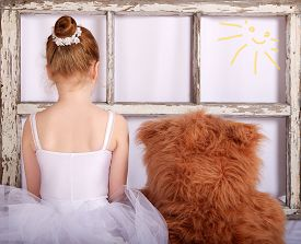 image of ballerina  - Unknown unrecognizable little girl with teddy bear - JPG