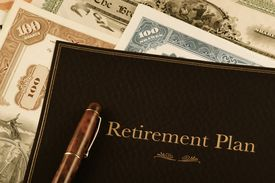 picture of nyse  - retirement plan portfolio on top of vintage stock certificates - JPG