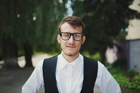 stock photo of nerd glasses  - photo of young man with nerd glasses - JPG