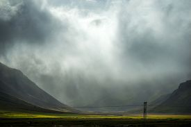 foto of iceland farm  - rain clouds over valley and farm in Iceland - JPG