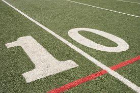 stock photo of tens  - Ten yard line on a diagonal of a astroturf football field - JPG