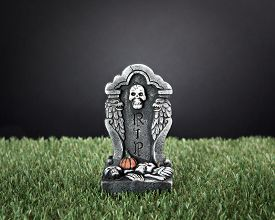 pic of tombstone  - Halloween RIP tombstone on green grass meadow - JPG