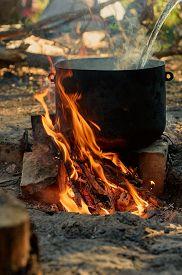 stock photo of rune  - Tourist kettle on camp fire - JPG
