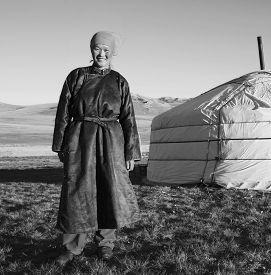 picture of mongolian  - Mongolian Woman Standing Tent Outdoors Tranquil Concept - JPG