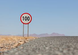 image of mph  - Speed limit sign at a desert road in Namibia speed limit of 100 kph or mph - JPG
