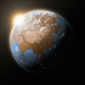 stock photo of southeast  - Sun over Southeast Asia on blue planet Earth isolated on black background - JPG