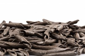 stock photo of cuttlefish  - italian seppia pasta fusilli (macaroni) with cuttlefish ink isolated on white background ** Note: Shallow depth of field - JPG