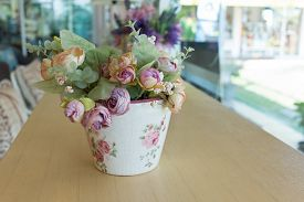 pic of decoupage  - flowers vase decoupage decorated on wooden table at living room artificial flowers in vase - JPG