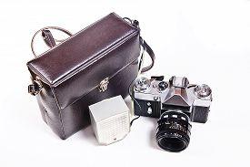 stock photo of flashing  - Old range finder vintage photo camera with flash isolated on white - JPG