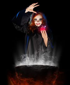picture of cauldron  - Young witch with red potion and cauldron  isolated - JPG