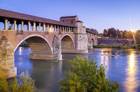 pic of suburban city  - Night view of the famous covered bridge of Pavia  - JPG