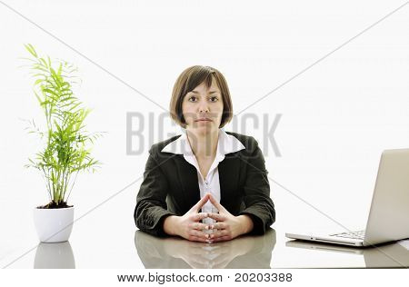 one young business woman isolated on white working on laptop computer