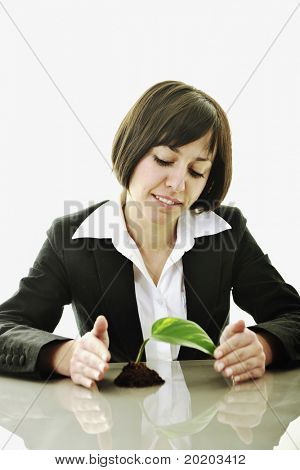 young business woman isolated on white holding green plant with small leaf and waiting to grow
