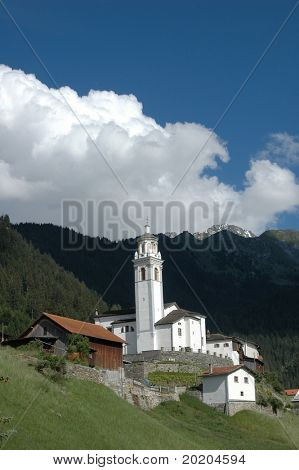 christian church in a swiss village on a sunny hot summer day