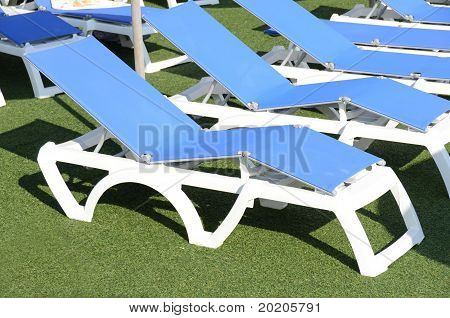 deckchairs beside the swimming pool