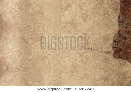 lovely brown background image with interesting texture, profile of a west african wooden statue and plenty of space for text