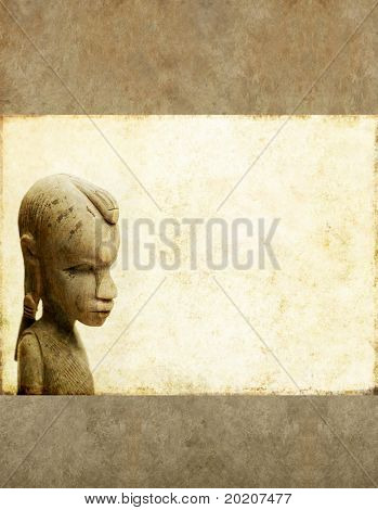 lovely background image with interesting texture, profile of a west african wooden statue and plenty of space for text