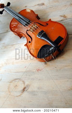 violin on a wooden table